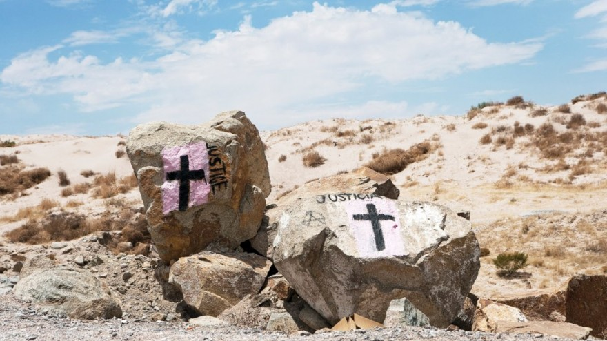 Around the city of Ciudad Juárez, one notices black crosses on a pink background