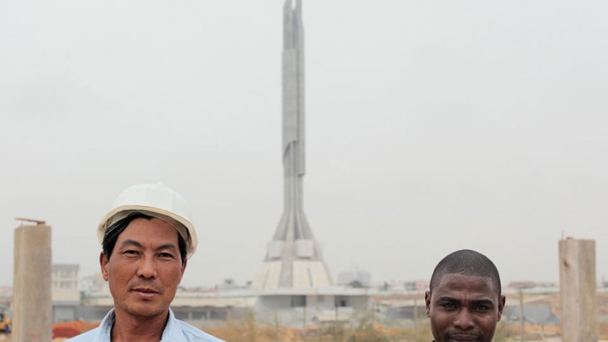 Chinese construction workers and Angolan interpreter outside the Mausoléu Agosti