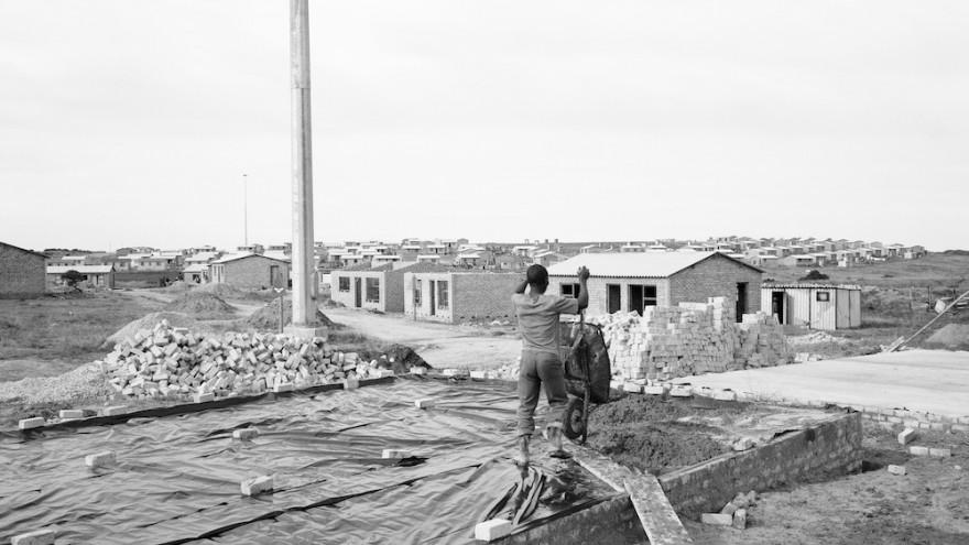 Man building his house, Marselle Township, Kenton-on-sea. 08 July 1990. Image: David Goldblatt.