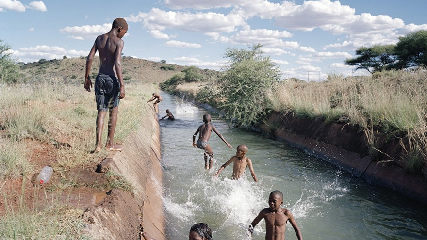 The suburb of Diamanthoogte (Diamond Heights) is home to a predominantly coloured community that lives on the outskirts of the diamond-mining town of Koffiefontein in the Free State province. During the summer months children enjoy swimming in the canals, which they refer to as the 'Long Sea'. Image: Ilan Godfrey.