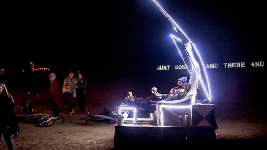 A roving sofa drives around at night.