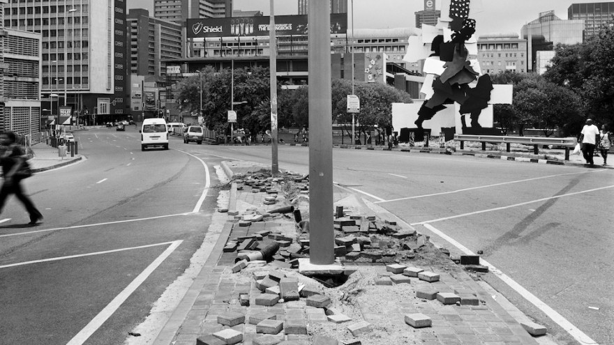 The City, The Firewalker and the aftermath of copper cable theft. Queen Elizabeth bridge, Johannesburg, 29 December 2011. Image: David Goldblatt.