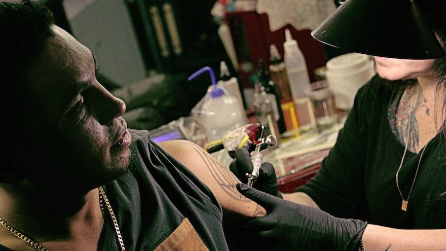 Tattoo artist Manuela Gray and Roger.