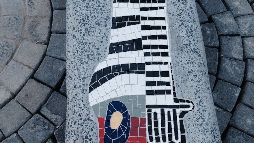 Running down the length of Shortmarket Street is an interrupted concrete bench, the form of which echoes the bold signature lines of the artist, Paul du Toit. This bench is to have a mosaic insert, and is to be part of the Rock Girl initiative: safe urban spaces.