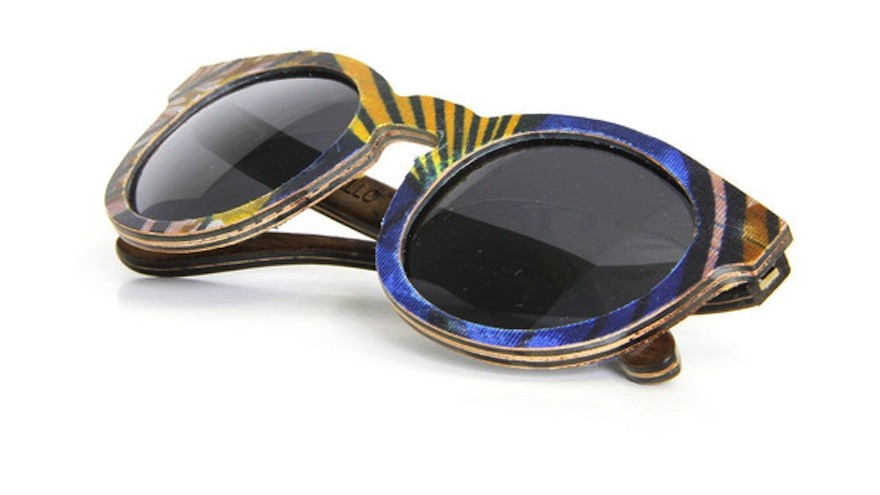 Ballo wooden eyewear is made locally from wood offcuts and recycled paper. This pair is covered with ShweShwe material.