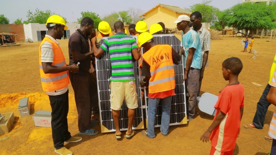 Locals are taught how to install solar panels.