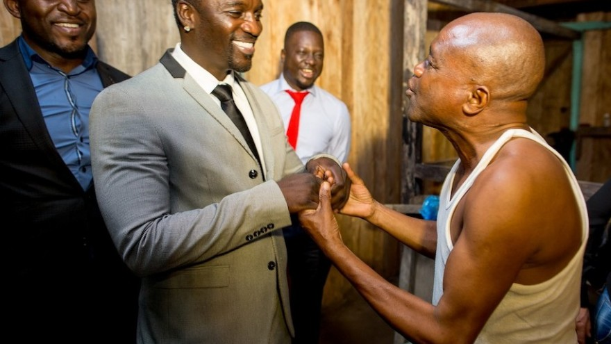 Akon and local villager.