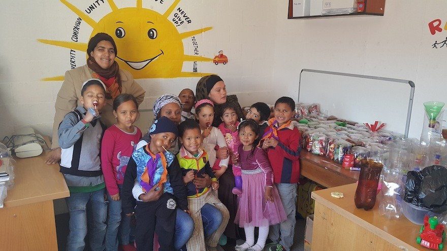 """Little People is a centre that caters for children with disabilities such as autism, aspergers and ADHD. On Mandela Day the staff at Little People ran workshops where their children made """"buckets of love"""" hand out"""