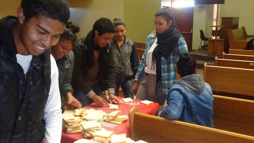 Daniel Engelbrecht helped young people at the NAC Strandfontein Village Youth church group distribute sandwiches, beanies and scarves to their local community.