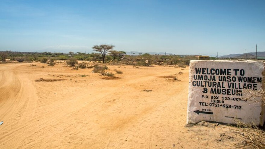 The sign for the Umoja Women's Village just outside Archers Post town in north Kenya's Samburu region.