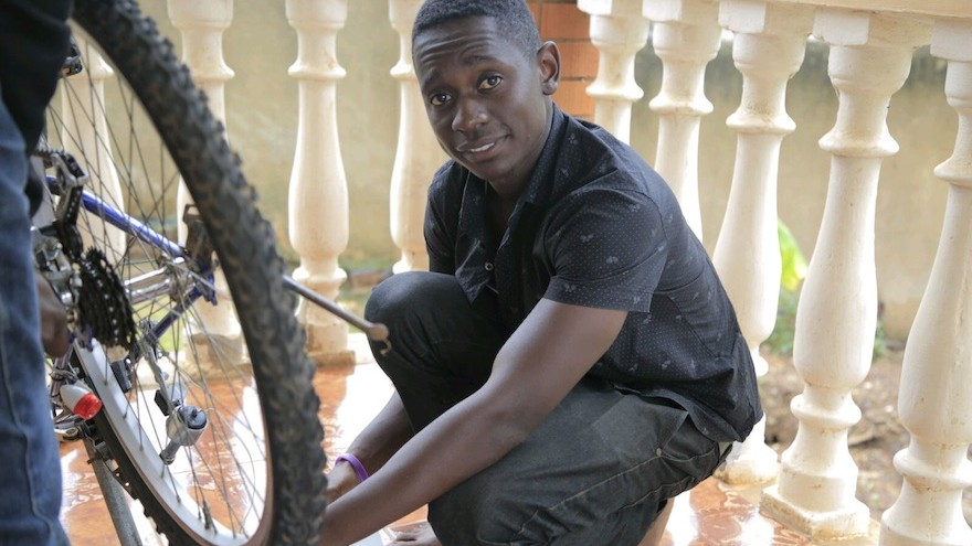 Elliot Mwebaze has developed a device that enables phones to charge using a bicycle dynamo