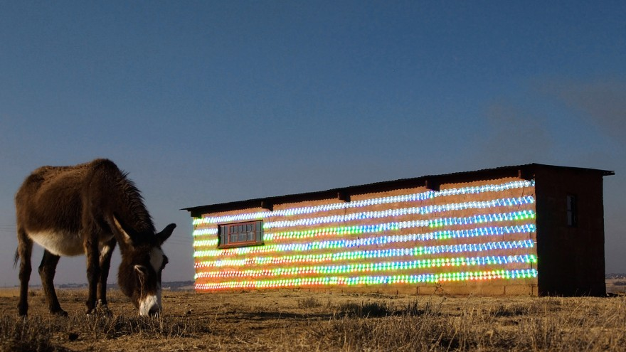 South African-based artist r1 used 1000 recycled CDs to clad an abandoned farmhouse in Randfontein, a mining city in western Gauteng.