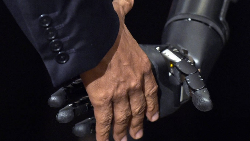 Robotic arm shakes hand