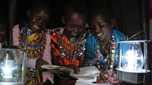 Children reading by Evans Wadongo's Mwangabora light.