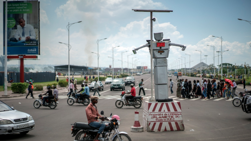 "Solar-powered robotic traffic cops have been ""hired"" to regulate the disorderly traffic in Kinshasa, the capital of the Democratic Republic of Congo."