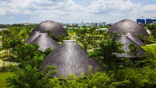 Vietnamese studio Vo Trong Nghia Architects have constructed eight thatched-roof domes that serve as a multi-functional community centre.
