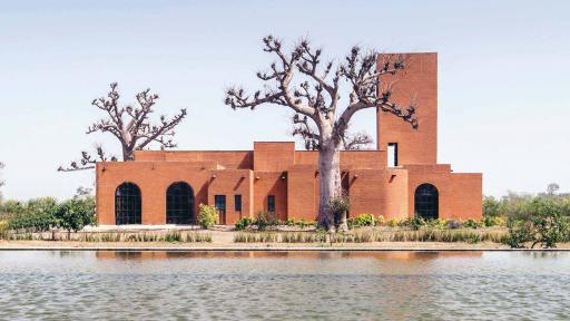 Designed by Senegalese architecture firm Atelier Koe, Al Hamra is an earth brick farmhouse located in the bush, away from the buzzing capital of Dakar.