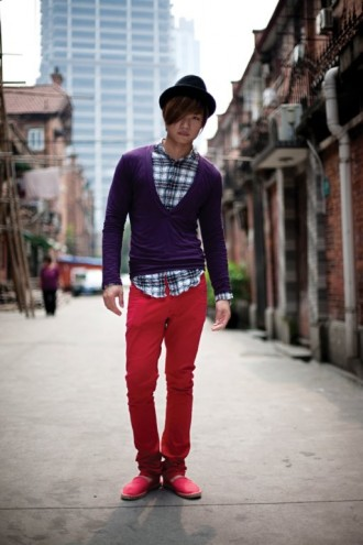 A trendy young man photographed in Huai Hai Fang, an old lane house compound off