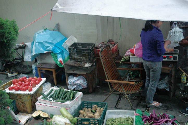 "A ""wet market"" where locals have a choice of affordable vegetables. Photo by ""Ju"