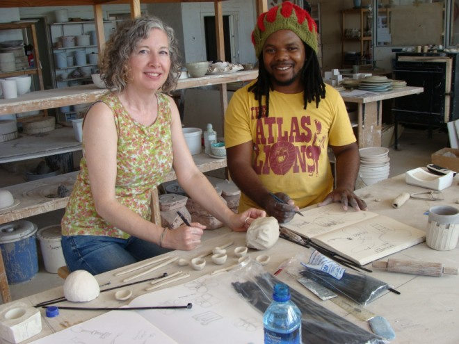Sarah Rhodes and Andile Dyalvane at work