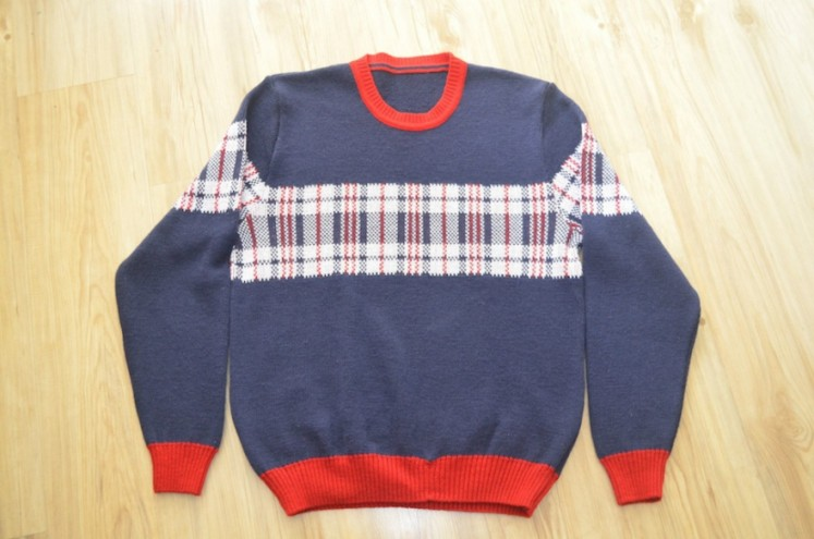 Nostalgia sweater by Dennis Chuene.