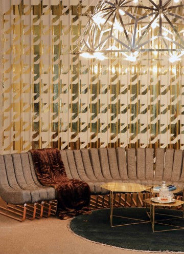 Haldane Martin's new Tesla Chandelier suspended above his iconic Songololo sofa and Hex coffee and side tables at the LEON At CCIX showroom. Image: Henk Hatting.