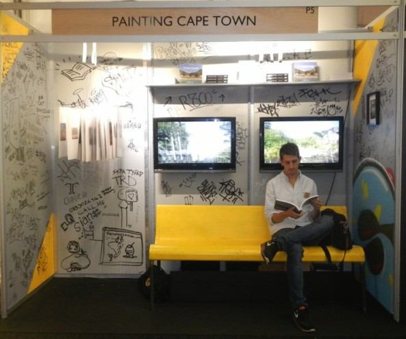 Matthew Olckers on his stand at Design Indaba Expo 2014. The stand design was inspired by the Metro train interiors in the signature grey and yellow.