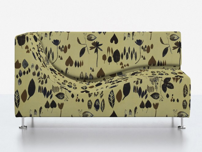 Couch covered in Foliage.