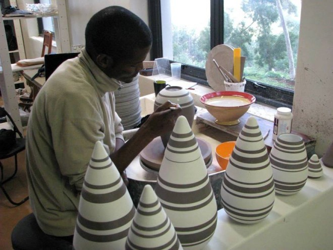 Ceramicist Chuma Maweni works on his tear drop canisters at Art In The Forest in Constantia.