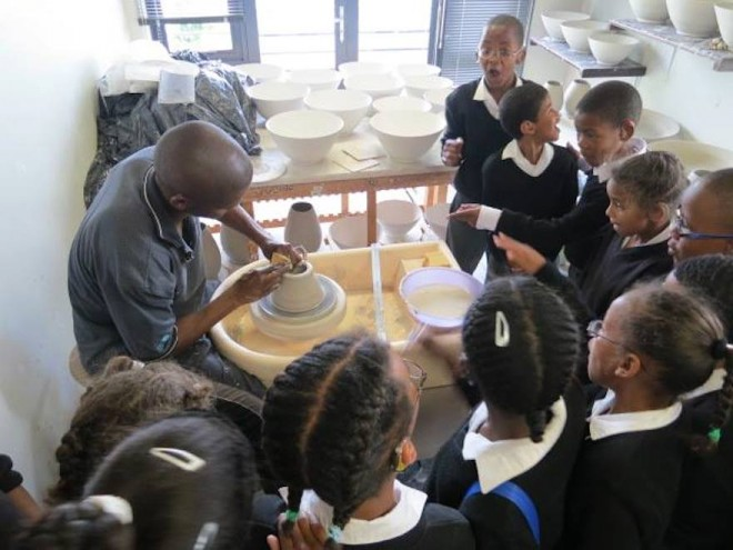 Chuma Maweni teaches children ceramics at Art In The Forest in Constantia.