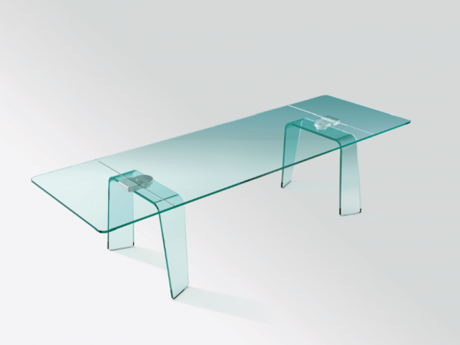 The Kayo Extensible Table fo FIAM, made of glass, has a discreet and innovative extendable mechanism embedded in its bent glass legs.