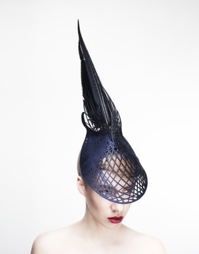 Sculpted out of wood, Emma Yeo's couture headwear makes a dramatic fashion statement
