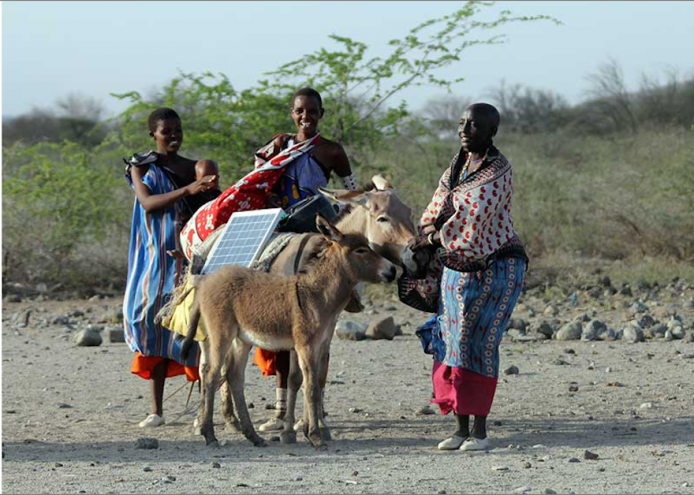 Maasai women deliver and instal solar panels around remote Kenyan villages. Image: Green Energy Africa