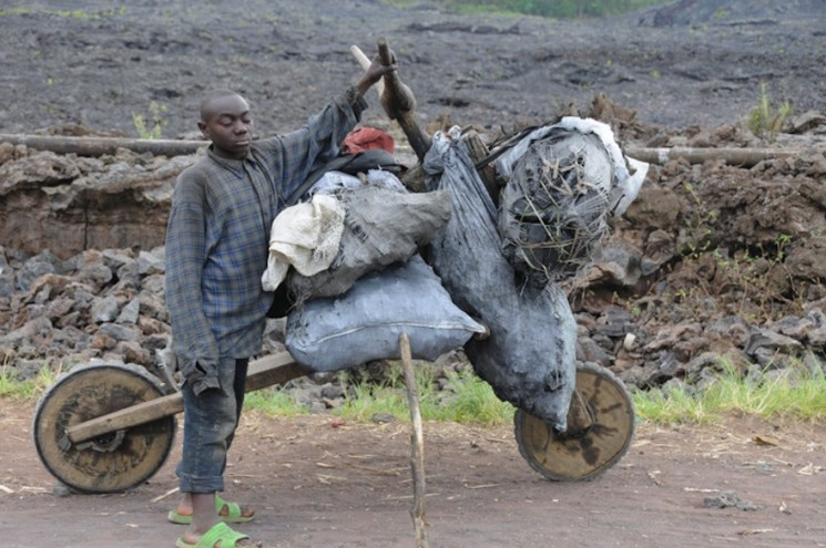 In eastern Congo, hand-hewn, low-tech scooters called chukudu's are a used to carry heaps of cargo, from food to fuel to bricks, across long distances. Image: Teon Voesen