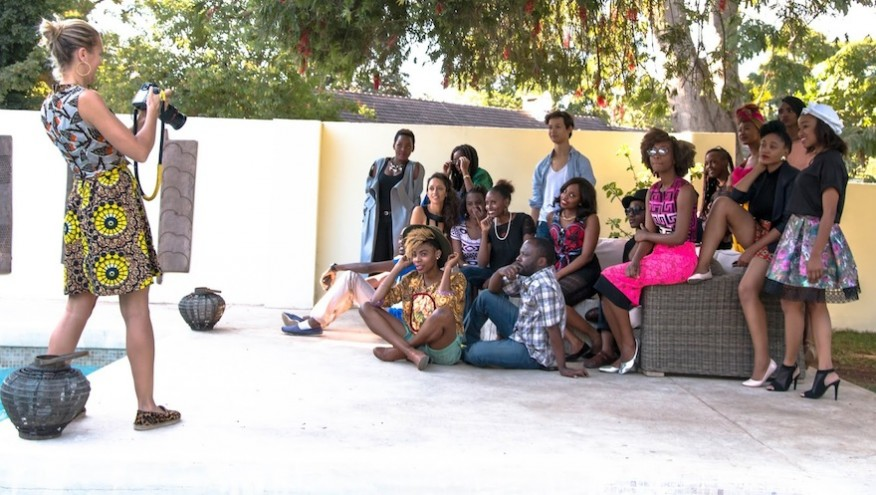 Joos takes a group photo, she is wearing a locally designed outfit by Musha Designs. Image: Vince Banda, R & G