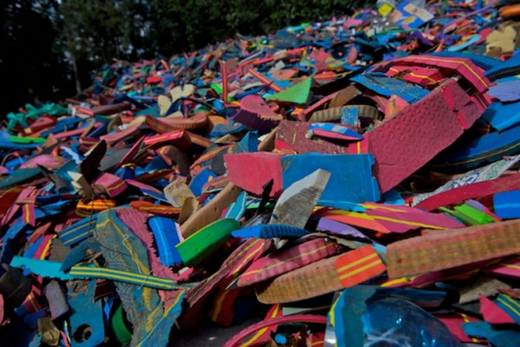 A mound of plastic on the beach.
