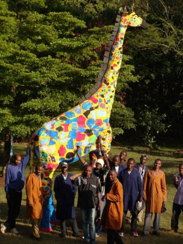 Crafters with their giraffe.