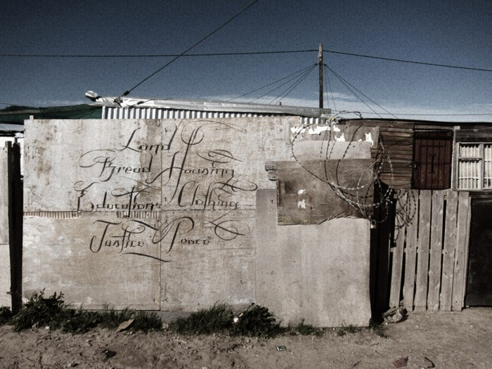 'a letter to the city of cape town from blikkiesdorp  - land, bread, housing, education, clothing, justice, peace.' by Faith47