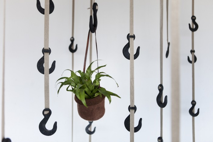 Ryan Frank upcycles plastic and grass to create a useful hanging storage.