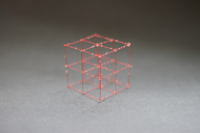 3D-weaving involves crisscrossing three-dimensional red strings