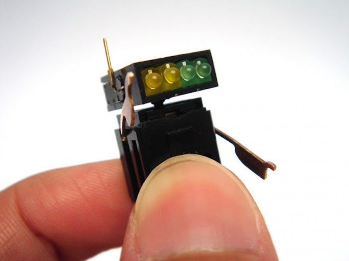 Singapore and Malaysia-based industrial designer Anthony Oh recycles electric parts into tiny robot sculptures