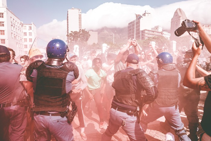 Imraan Christian's photographs capture the tension between students and police on SA's day mass action.