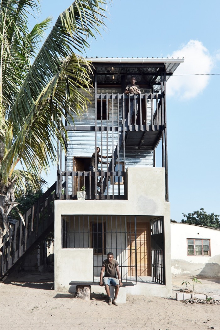 Low cost house in mozambique features corrugated iron and for Architect house plans cost