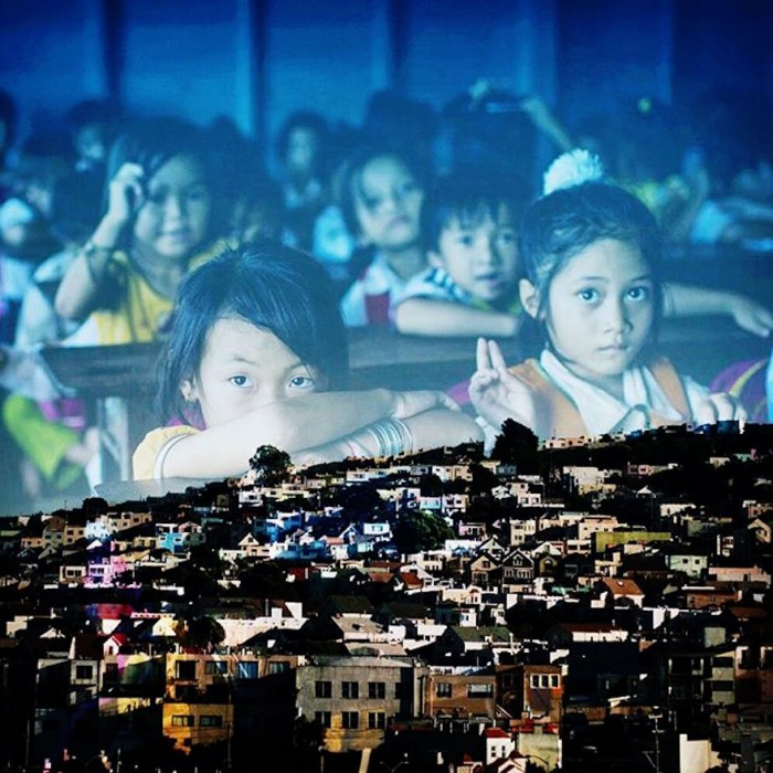 In this mashup, a photo by @domvalentephoto of school children in rural Cambodia appear to be resting their arms on an image of the Excelsior district San Francisco by @jachristian