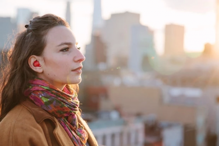 Furturistic earpiece translates conversations in real-time.