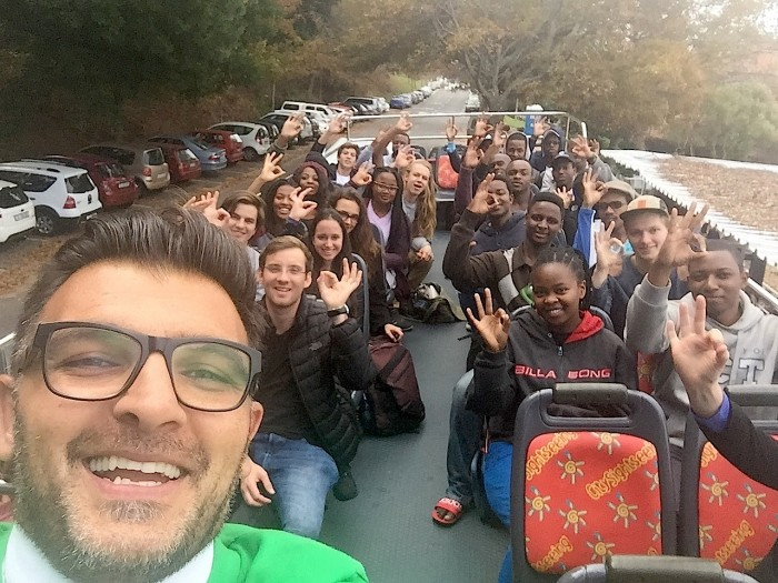 UCT Upstarts students on a bus ride with trend specialist John Sanei.