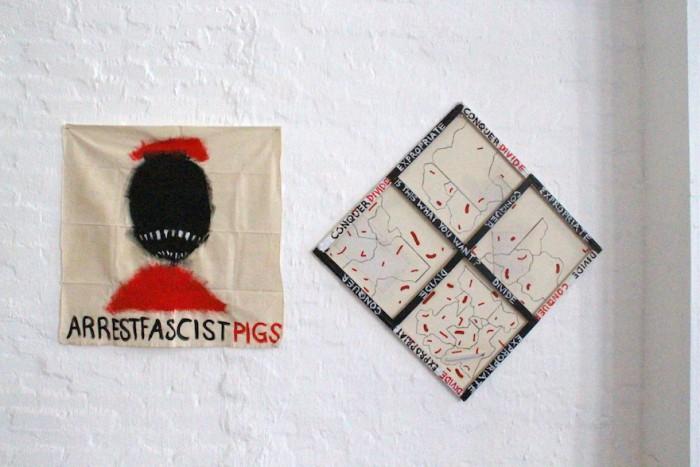 Artist: Brendon Erasmus. Title: Arrest Fascist Pigs. Medium: Mixed Media. Emergency: Land re-appropriation.