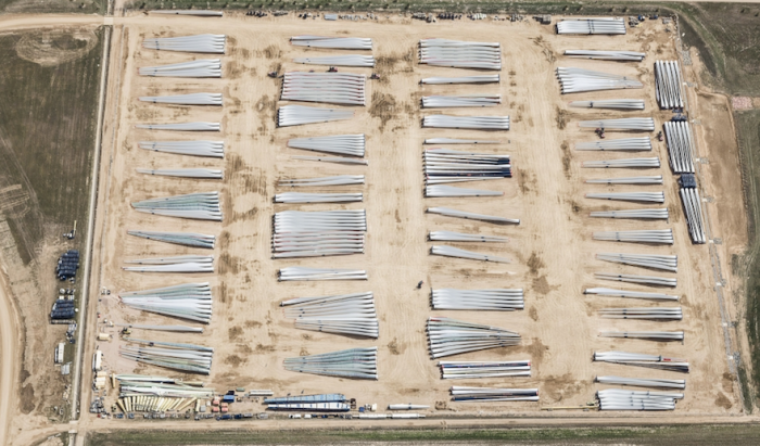 Blades, Windsor, CO, 2016: Wind turbine blades look like matchsticks as they await shipment from this manufacturing facility near Windsor.