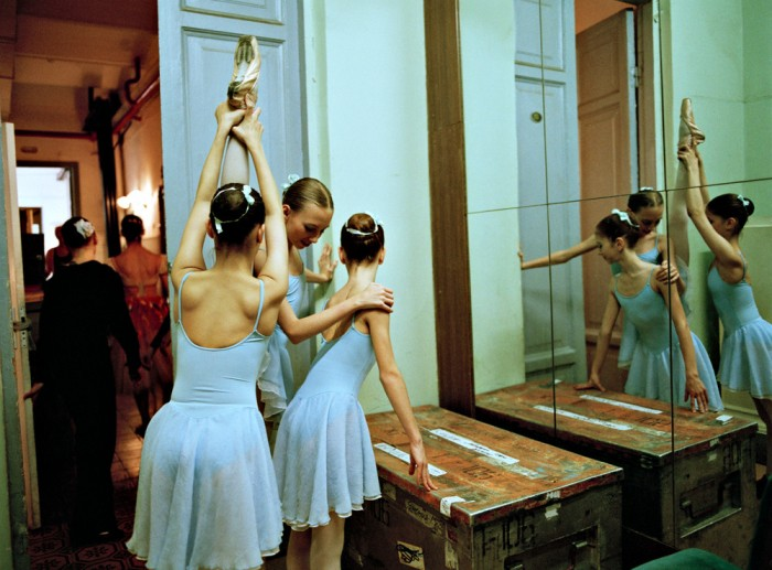Trio of dancers in front of mirror