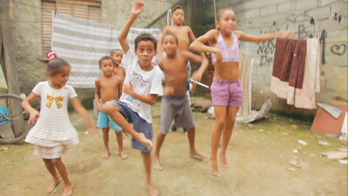 Caetano Fernandes dancing with his siblings in their back yard, Mesquita, Chatuba, Rio de Janeiro, via Liberty Express Kickstarter page